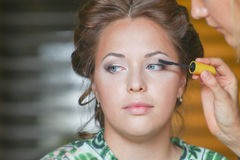 Woman make bridal makeup for eyelashes and eye by brush for mascara Stock Photo