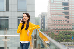 Woman make a call by mobile phone Royalty Free Stock Images