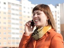 Woman make a call on modern background Stock Image