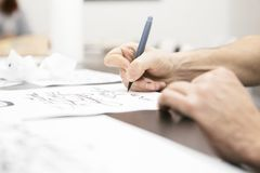 Woman make calligraphy writings, make art on a paper using pen b. Rush and sign pen. Adult, old hands of a calligrapher man. Lifestyle image of a design process royalty free stock image
