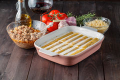 Woman make cannelloni with cheess Royalty Free Stock Image