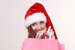 Woman make christmas shopping. Royalty Free Stock Photography