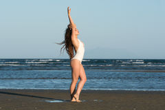 Woman make a dance moves at the beach Royalty Free Stock Images
