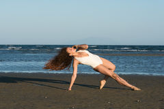 Woman make a dance moves at the beach Stock Photo