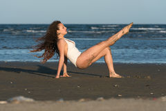Woman make a dance moves at the beach Stock Image