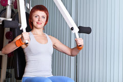 Woman make exercise on training apparatus Stock Photo