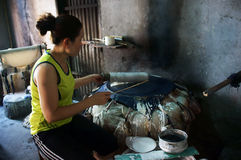 Woman make girdle cake (banh trang).BA RIA, VIET NAM- FEBRUARY 2 Royalty Free Stock Photos