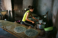 Woman make girdle cake (banh trang).BA RIA, VIET NAM- FEBRUARY 2 Royalty Free Stock Images