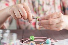 Woman make handmade jewellery Royalty Free Stock Photo