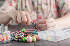 Woman make handmade jewellery Royalty Free Stock Image