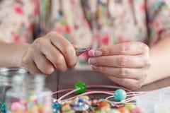 Woman make handmade jewellery Royalty Free Stock Images