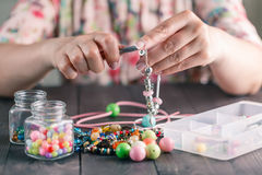 Woman make homemade bracelet royalty free stock photo