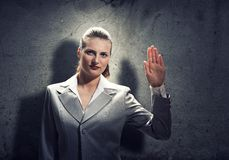 Woman make oath. Young businesswoman with hand up taking an oath Stock Images
