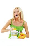 Woman make an orange juice Stock Images
