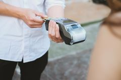 Woman make payment with credit card swipe through terminal. cust. Omer paying with EDC or swiping machine. buy and sell product or service Stock Photography