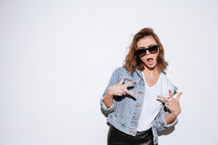 Woman make peace gesture with mouth opened. Royalty Free Stock Image