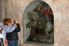 Woman make photo statue of Saint George in the Church of the Nat Royalty Free Stock Images