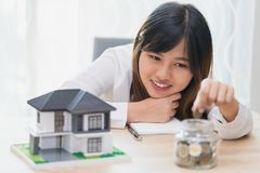 Woman make a save money for buy new house concept stock photo