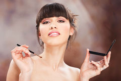 Woman and make up. Pretty woman make up with brush stock photo