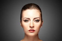 Woman with make-up. Portrait of young beautiful woman with stylish make-up on a dark background royalty free stock photos