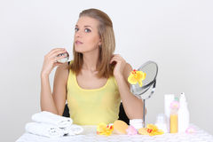 Woman with make up accessories and mirror Stock Image