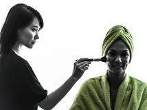 Woman and make up artist  silhouette Stock Photo