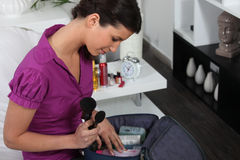 Woman with make-up bag Royalty Free Stock Images