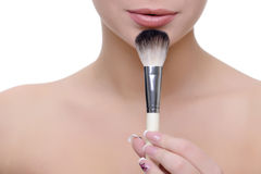 Woman with make-up brush Royalty Free Stock Photography