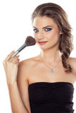 Woman with a make-up brush Stock Photo