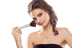 Woman with a make-up brush Royalty Free Stock Photo