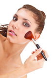 Woman with a make-up brush Stock Photos