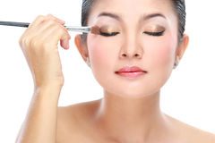 Woman with a make up brush Stock Photo