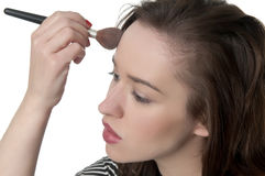 Woman with make-up brush Stock Photography