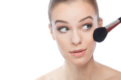 Woman with make-up brush. Close up. Royalty Free Stock Photos