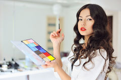 Woman with make up brush and palette Stock Photography