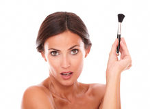 Woman with make up brush for pampering her face Royalty Free Stock Images