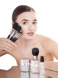 Woman with make-up brush set. Stock Photos