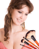Woman with a make-up brushes Royalty Free Stock Photography
