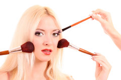 woman with   make-up  brushes Royalty Free Stock Image