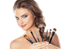 Woman with make-up brushes Royalty Free Stock Images