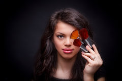 Woman with make-up brushes Stock Images