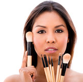 Woman with make up brushes Stock Photography