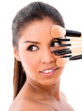 Woman with make-up brushes Royalty Free Stock Photos