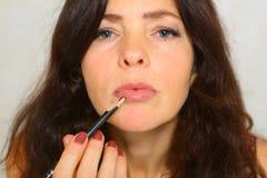 Woman Make-up lips Lipgloss. Lipstick Stock Images