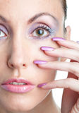 Woman with a make-up  and  long nails Royalty Free Stock Photos