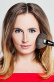 Woman with Make up  and Makeup Brush Stock Photo