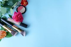 Woman make up products and accessories on blue background royalty free stock photos