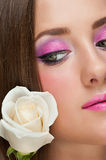 Woman with make-up with rose Stock Photo