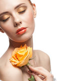 Woman with make-up and rose Stock Image