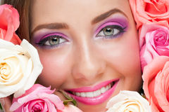 Woman with make-up and roses stock image